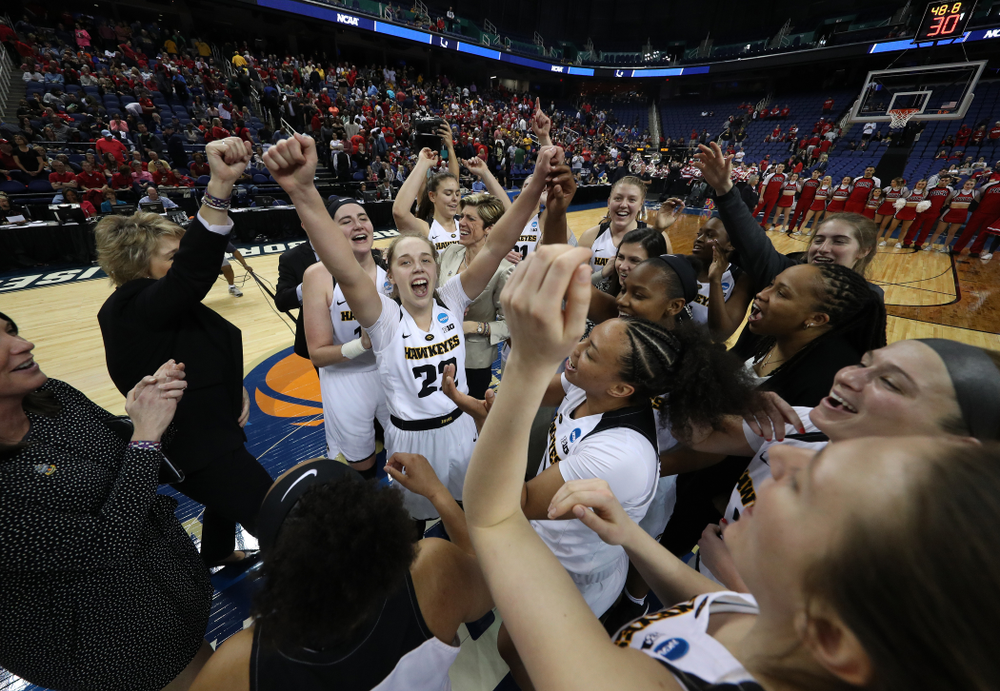 The Iowa Hawkeyes celebrate their victory over the NC State Wolfpack in the regional semi-final of the 2019 NCAA Women's College Basketball Tournament Saturday, March 30, 2019 at Greensboro Coliseum in Greensboro, NC.(Brian Ray/hawkeyesports.com)