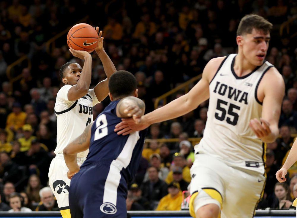 Iowa Hawkeyes guard Bakari Evelyn (4) knocks down a three point basket against Penn State Saturday, February 29, 2020 at Carver-Hawkeye Arena. (Brian Ray/hawkeyesports.com)
