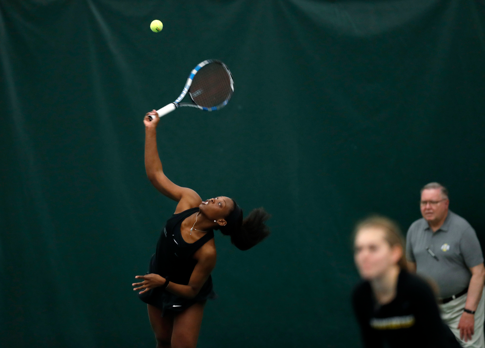 Adorable Huckleby and Zoe Douglas play a doubles match against Ohio State Sunday, March 25, 2018 at the Hawkeye Tennis and Recreation Center. (Brian Ray/hawkeyesports.com)