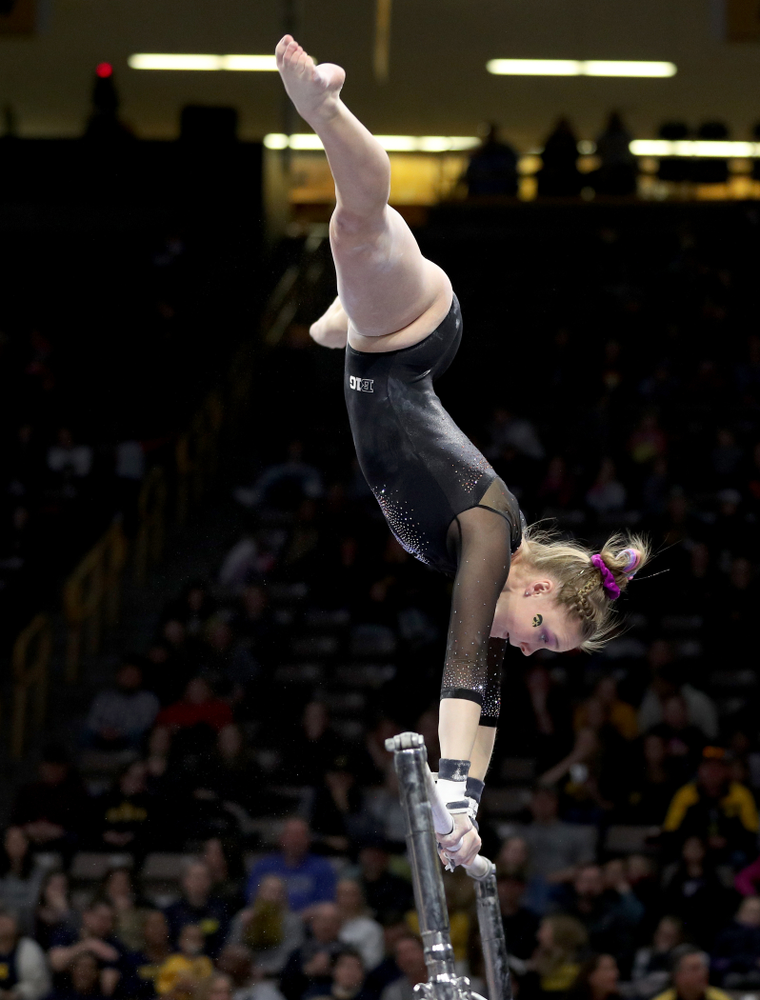 Iowa's Allyson Steffensmeier competes on the bars against Michigan Friday, February 14, 2020 at Carver-Hawkeye Arena. (Brian Ray/hawkeyesports.com)