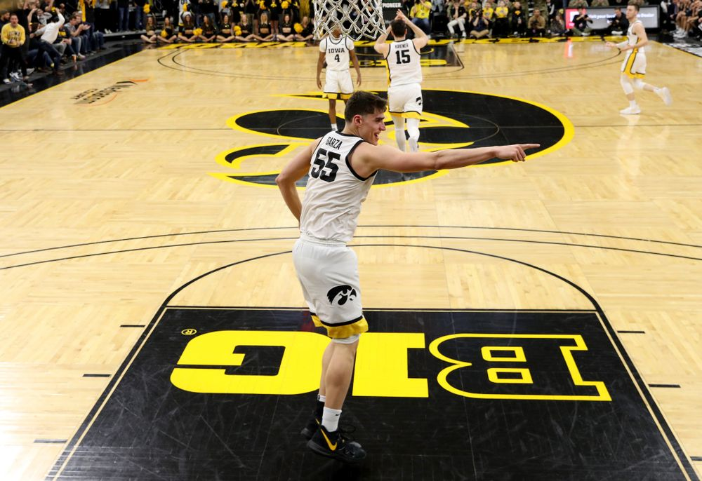 Iowa Hawkeyes forward Luka Garza (55) celebrates a dunk against Penn State Saturday, February 29, 2020 at Carver-Hawkeye Arena. (Brian Ray/hawkeyesports.com)
