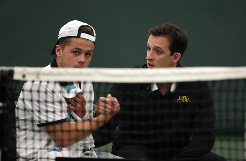 Iowa's Will Davies and Iowa assistant coach Joey Manilla against Western Michigan Saturday, January 19, 2019 at the Hawkeye Tennis and Recreation Complex. (Brian Ray/hawkeyesports.com)