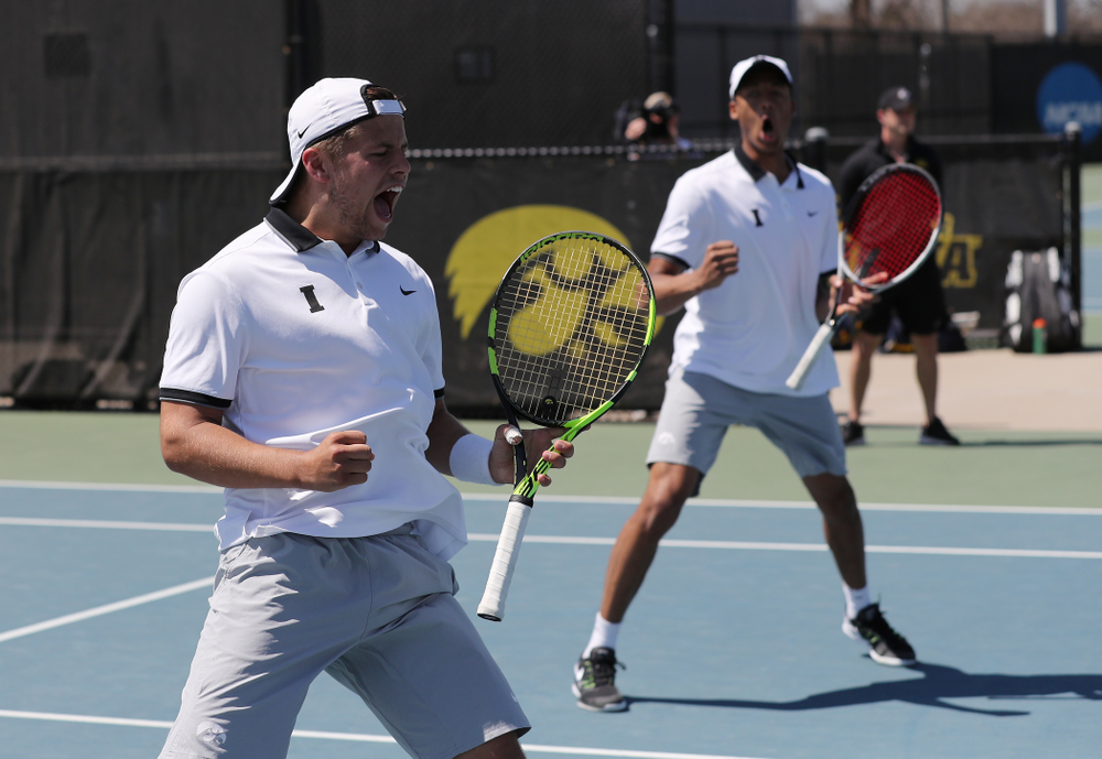 IowaÕs Oliver Okonkwo and Will Davies play a doubles match against the Michigan Wolverines Sunday, April 21, 2019 at the Hawkeye Tennis and Recreation Complex. (Brian Ray/hawkeyesports.com)