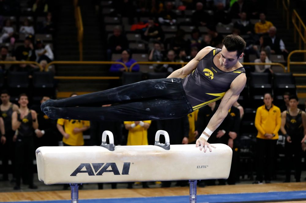 Austin Hodges competes on the pommel horse against Illinois