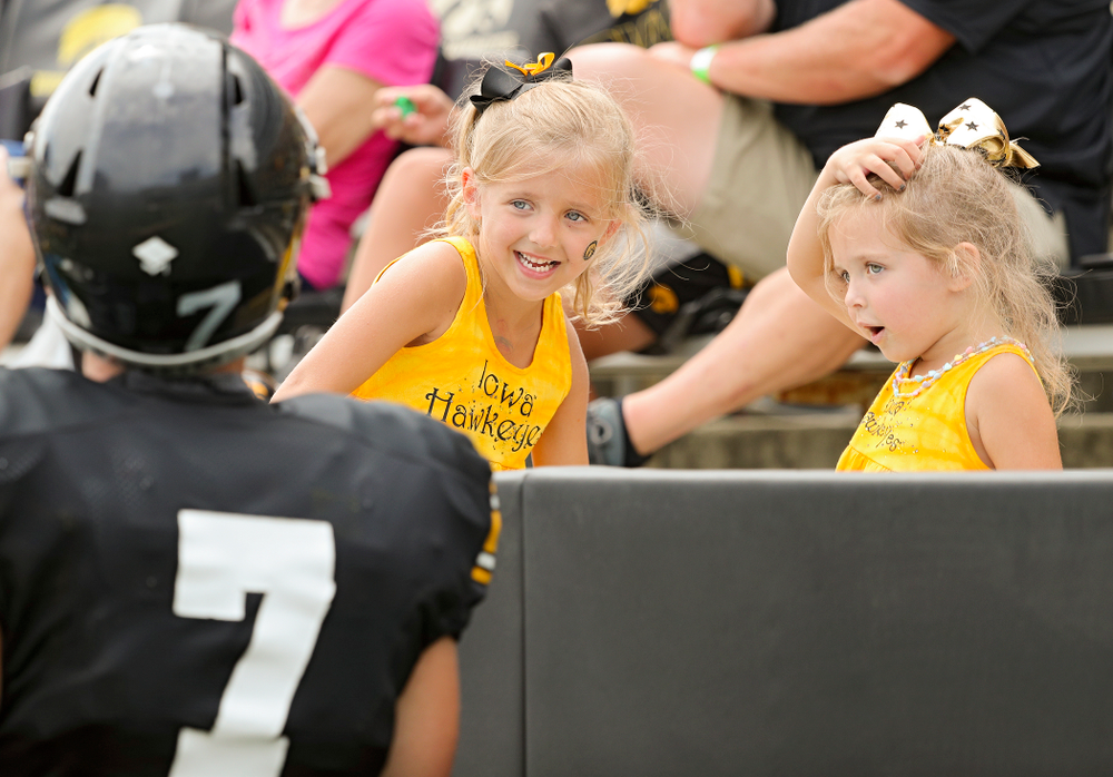 Two young fans talk with Iowa Hawkeyes punter Colten Rastetter (7) during Fall Camp Practice No. 8 at Kids Day at Kinnick Stadium in Iowa City on Saturday, Aug 10, 2019. (Stephen Mally/hawkeyesports.com)