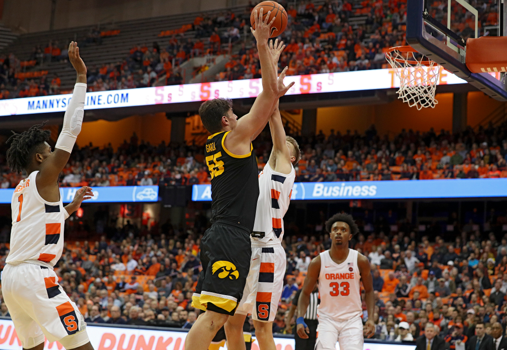 Iowa Hawkeyes center Luka Garza (55) makes a basket during the second half of their ACC/Big Ten Challenge game at the Carrier Dome in Syracuse, N.Y. on Tuesday, Dec 3, 2019. (Stephen Mally/hawkeyesports.com)