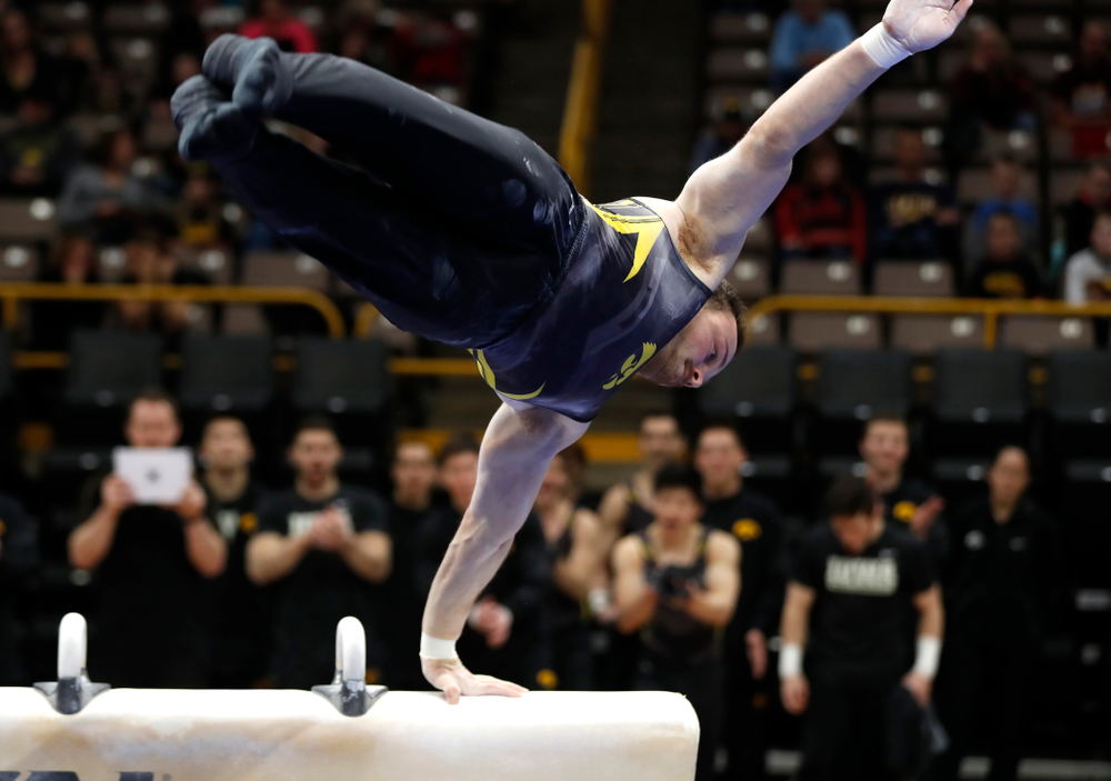Dylan Ellsworth competes on the pommel horse  against Minnesota and Air Force