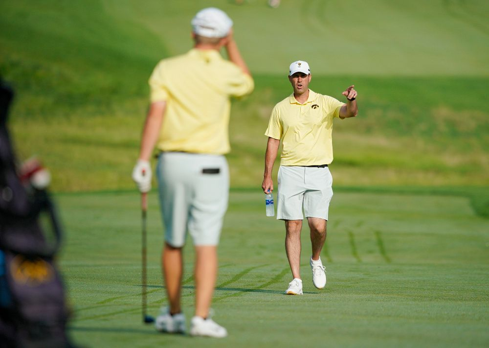 Iowa's Matthew Garside (from left) talks with head coach Tyler Stith during the third day of the Golfweek Conference Challenge at the Cedar Rapids Country Club in Cedar Rapids on Tuesday, Sep 17, 2019. (Stephen Mally/hawkeyesports.com)