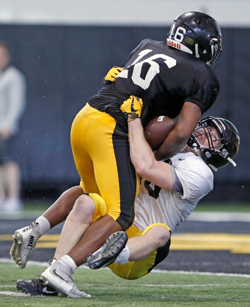 Kyshaun Bryan, John Milani -- University of Iowa spring football practice No. 6 on March 31, 2018, in Iowa City, Iowa. (Darren Miller/hawkeyesports.com)