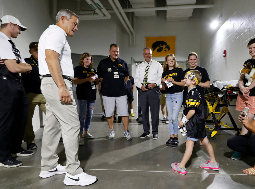 Iowa Hawkeyes head coach Kirk Ferentz  talks with Kid  Captain Harper Stribe and her family before the Hawkeyes game against the Iowa State Cyclones Saturday, September 8, 2018 at Kinnick Stadium. (Brian Ray/hawkeyesports.com)