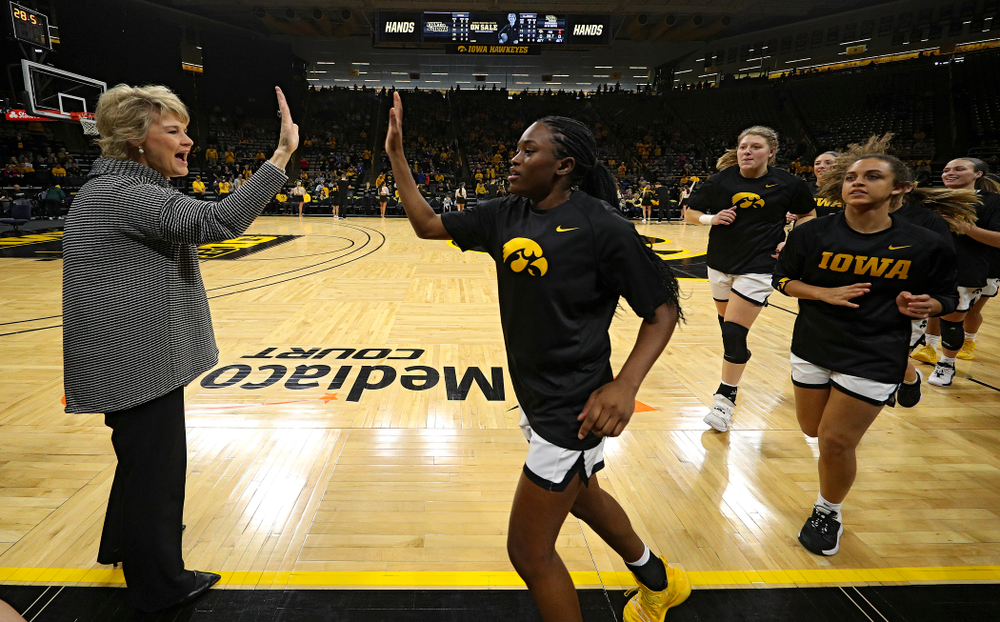 Iowa Hawkeyes head coach Lisa Bluder gives guard Tomi Taiwo (1) a high-five before their game at Carver-Hawkeye Arena in Iowa City on Tuesday, December 31, 2019. (Stephen Mally/hawkeyesports.com)