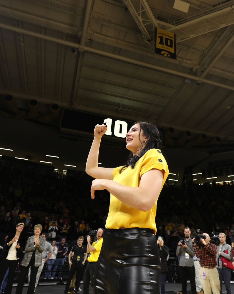 Megan Gustafson smiles after her number was raised into the rafters during a jersey retirement ceremony Sunday, January 26, 2020 at Carver-Hawkeye Arena. (Brian Ray/hawkeyesports.com)