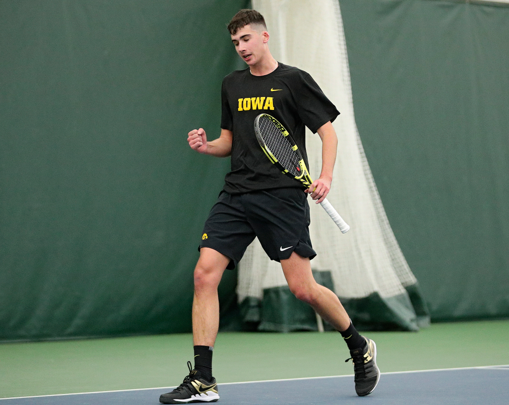 Iowa's Matt Clegg celebrates a point during their match at the Hawkeye Tennis and Recreation Complex in Iowa City on Thursday, January 16, 2020. (Stephen Mally/hawkeyesports.com)
