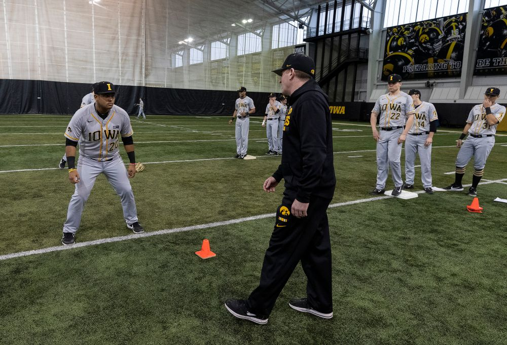 Iowa Hawkeyes associate head coach Marty Sutherland works on base running following the team's annual media day Tuesday, February 5, 2019 in the Indoor Practice Facility. (Brian Ray/hawkeyesports.com)