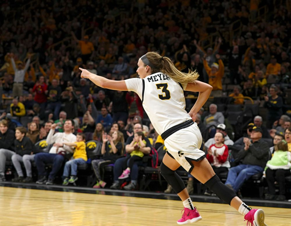 Iowa Hawkeyes guard Makenzie Meyer (3) points to her teammate after scoring a basket during the second quarter of their game at Carver-Hawkeye Arena in Iowa City on Saturday, December 21, 2019. (Stephen Mally/hawkeyesports.com)