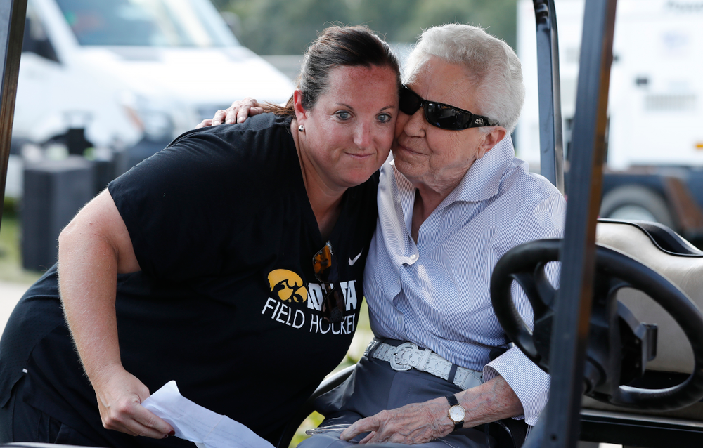 Dr. Christine Grant hugs head coach Lisa Cellucci during an alumni reunion Sunday, September 16, 2018 at Grant Field. (Brian Ray/hawkeyesports.com)