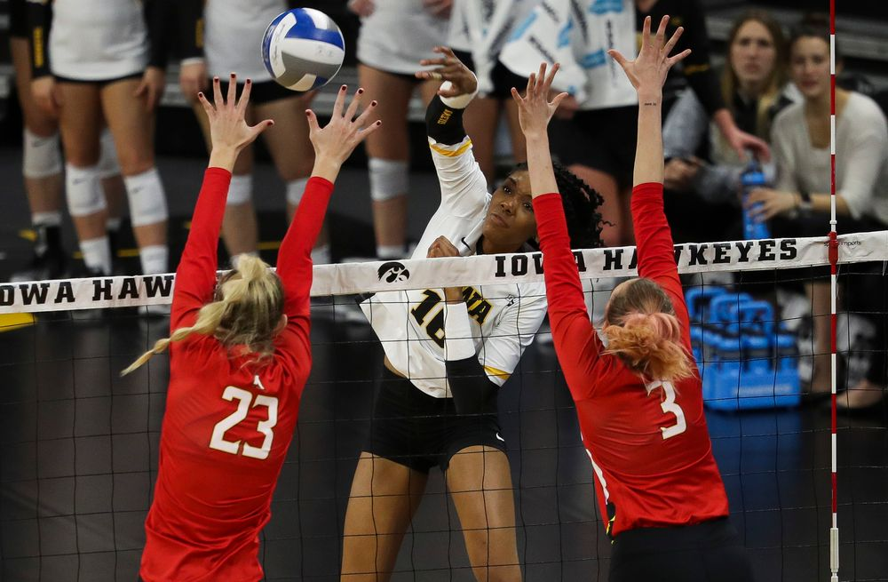 Iowa Hawkeyes outside hitter Taylor Louis (16) spikes the ball during a match against Maryland at Carver-Hawkeye Arena on November 23, 2018. (Tork Mason/hawkeyesports.com)