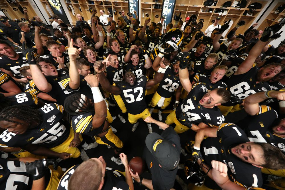 The Iowa Hawkeyes sing the ÒFight SongÓ following their victory over the Rutgers Scarlet Knights Saturday, September 7, 2019 at Kinnick Stadium. (Brian Ray/hawkeyesports.com)