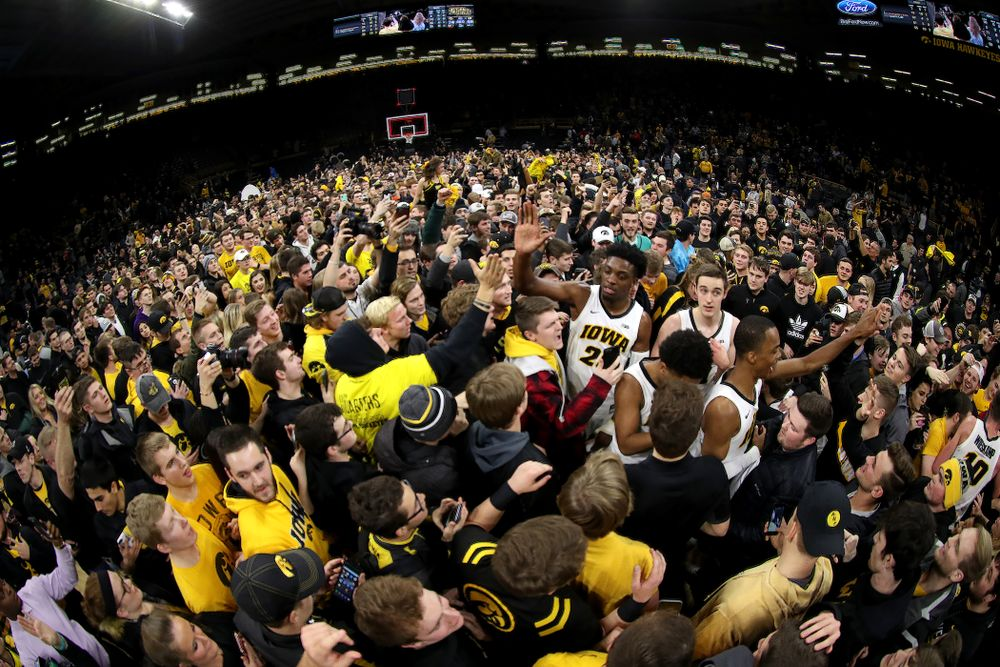 Iowa Hawkeyes guard Maishe Dailey (1) and forward Tyler Cook (25) celebrate with fans after defeating the Michigan Wolverines  Friday, February 1, 2019 at Carver-Hawkeye Arena. (Brian Ray/hawkeyesports.com)