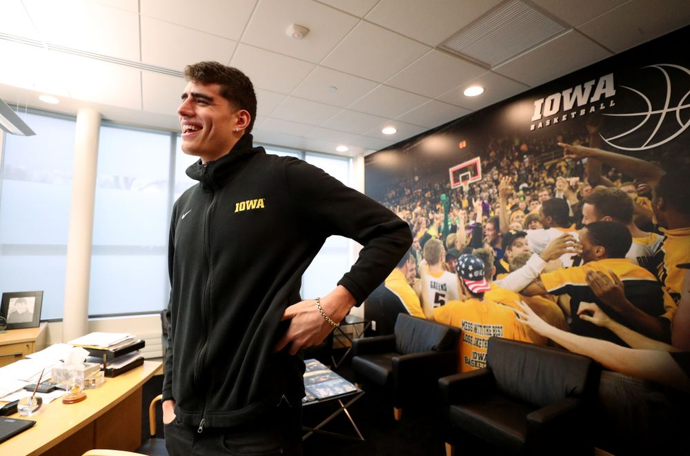 Iowa Hawkeyes forward Luka Garza (55) smiles after finding out that he has been named the Big Ten Player of the Year Monday, March 9, 2020 at Carver-Hawkeye Arena. (Brian Ray/hawkeyesports.com)