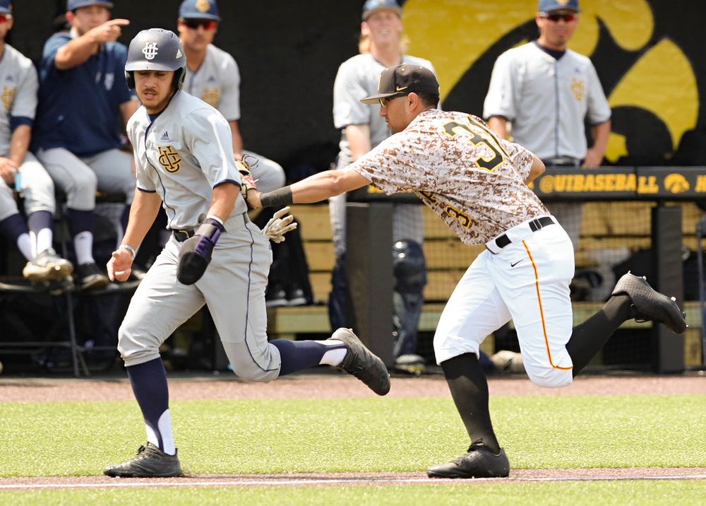Iowa Hawkeyes third baseman Matthew Sosa (31) tags out a runner during the third inning of their game against UC Irvine at Duane Banks Field in Iowa City on Sunday, May. 5, 2019. (Stephen Mally/hawkeyesports.com)