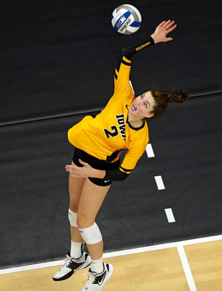 Iowa's Courtney Buzzerio (2) gets up for a kill during the fourth set of their match at Carver-Hawkeye Arena in Iowa City on Friday, Nov 29, 2019. (Stephen Mally/hawkeyesports.com)