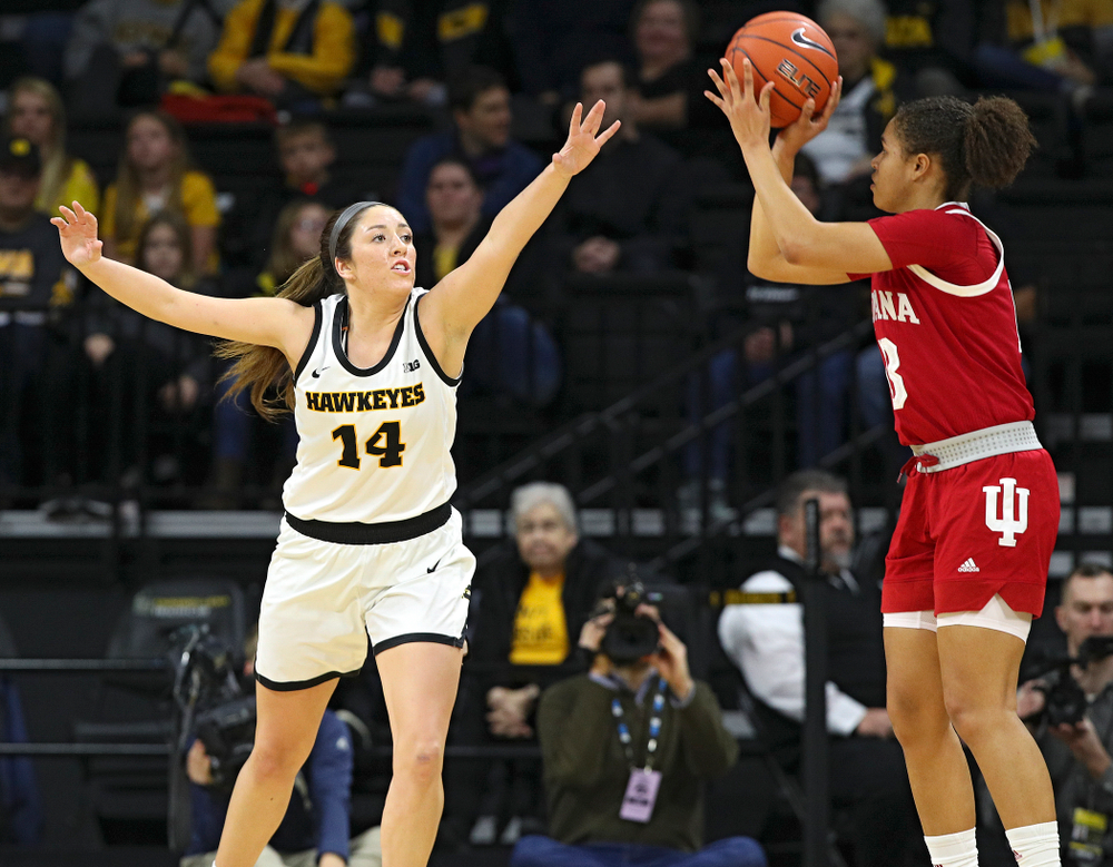 Iowa Hawkeyes guard Mckenna Warnock (14) defends during the first quarter of their game at Carver-Hawkeye Arena in Iowa City on Sunday, January 12, 2020. (Stephen Mally/hawkeyesports.com)