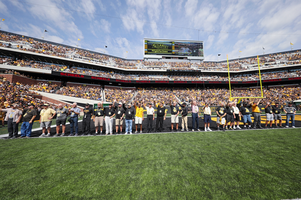 Members of the Iowa Hawkeyes 1969 football team are recognized during the third quarter of their Big Ten Conference football game at Kinnick Stadium in Iowa City on Saturday, Sep 7, 2019. (Stephen Mally/hawkeyesports.com)