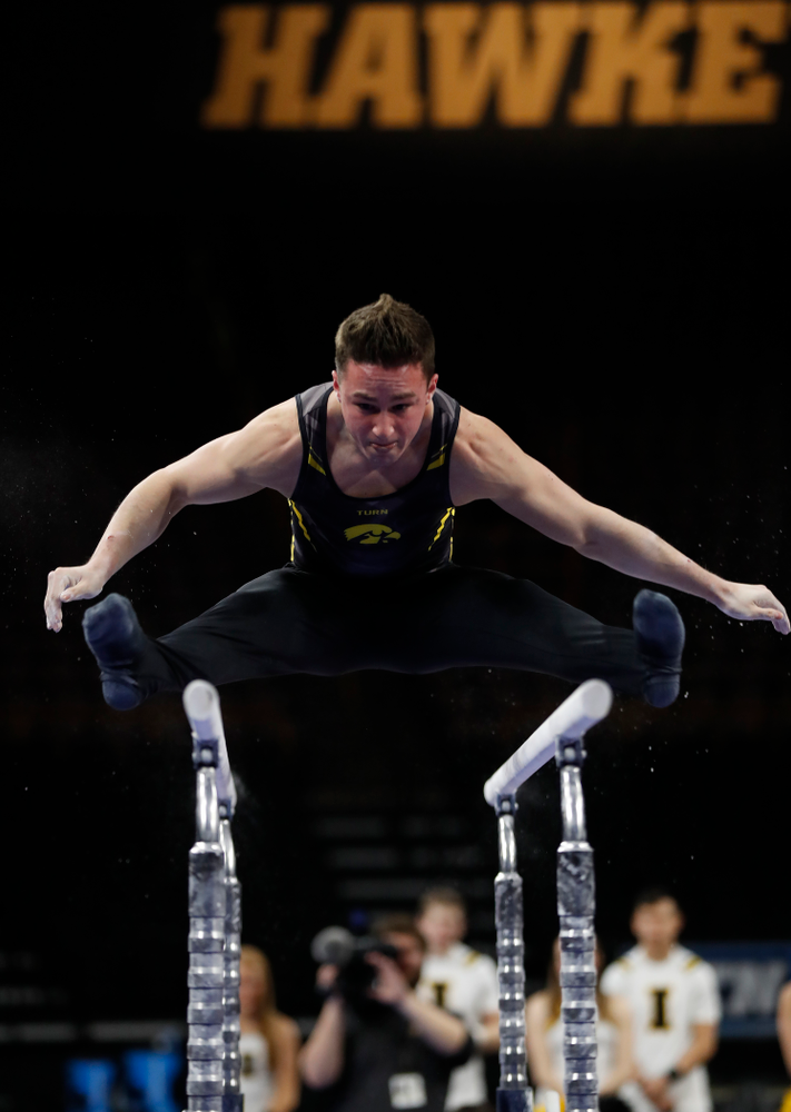 Iowa's Jake Brodarzon competes on the bars