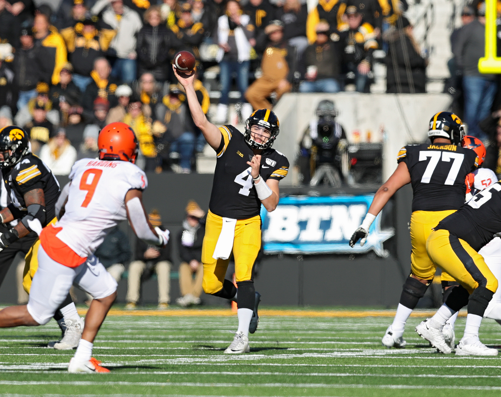 Iowa Hawkeyes quarterback Nate Stanley (4) throws a pass during the first quarter of their game at Kinnick Stadium in Iowa City on Saturday, Nov 23, 2019. (Stephen Mally/hawkeyesports.com)