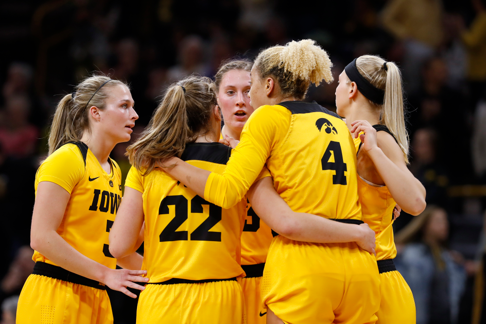 Iowa Hawkeyes guard Makenzie Meyer (3) and forward Amanda Ollinger (43)