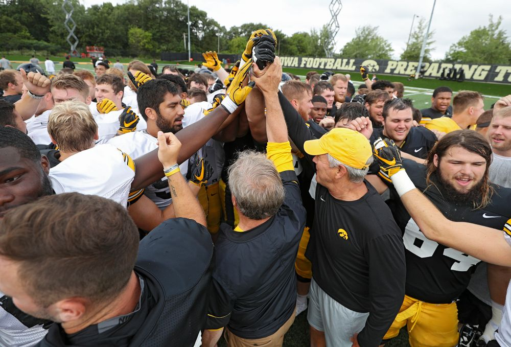 University of Iowa President Bruce Harreld and Iowa Hawkeyes head coach Kirk Ferentz huddle with the team during Fall Camp Practice No. 10 at the Hansen Football Performance Center in Iowa City on Tuesday, Aug 13, 2019. (Stephen Mally/hawkeyesports.com)