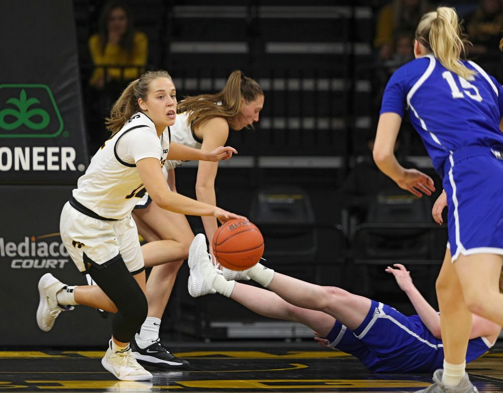 Iowa Hawkeyes guard Kathleen Doyle (22) steals the ball away during the first quarter of their game at Carver-Hawkeye Arena in Iowa City on Saturday, December 21, 2019. (Stephen Mally/hawkeyesports.com)