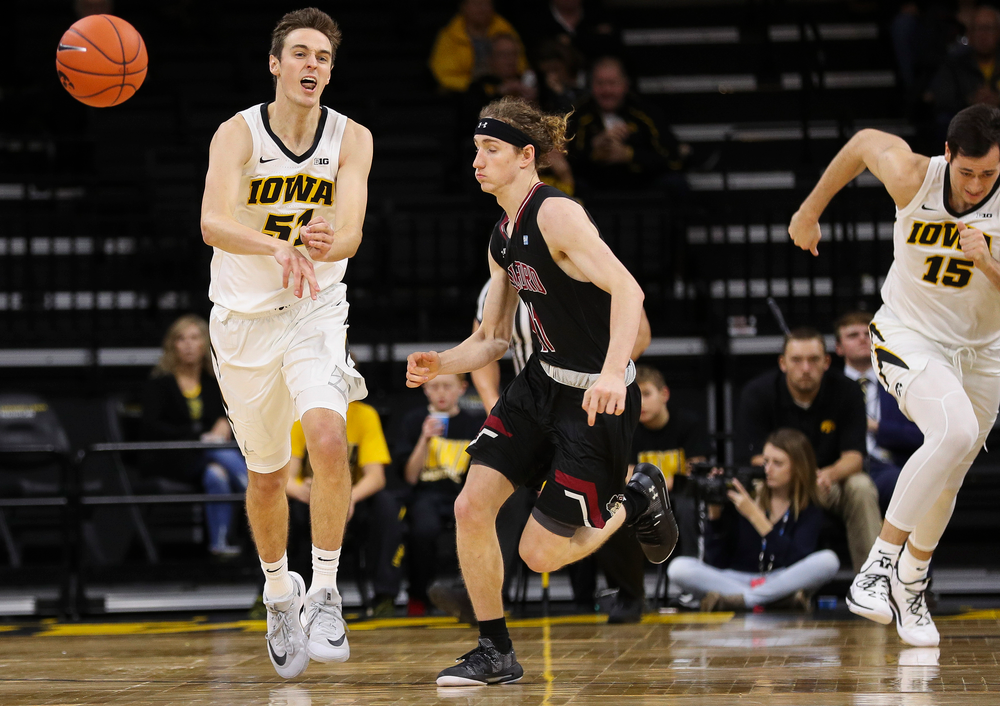 Iowa Hawkeyes forward Nicholas Baer (51) makes an outlet pass during a game against Guilford College at Carver-Hawkeye Arena on November 4, 2018. (Tork Mason/hawkeyesports.com)