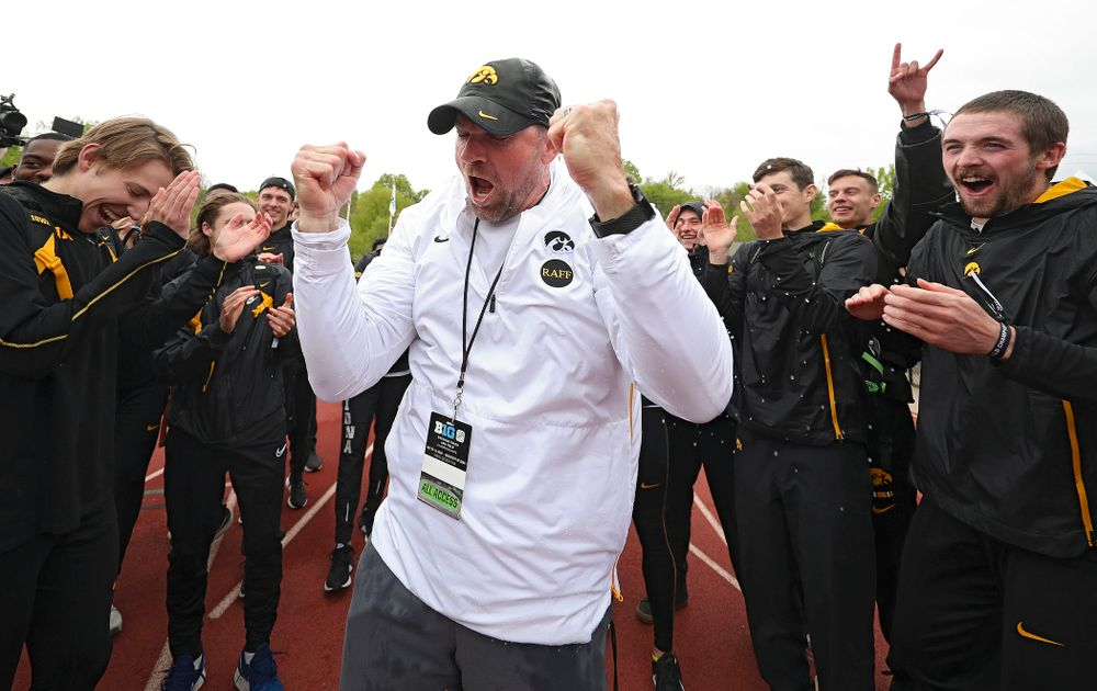 Iowa Director of Track and Field Joey Woody celebrates with his team after winning the Men's Big Ten Outdoor Track and Field Championships on the third day of the Big Ten Outdoor Track and Field Championships at Francis X. Cretzmeyer Track in Iowa City on Sunday, May. 12, 2019. (Stephen Mally/hawkeyesports.com)