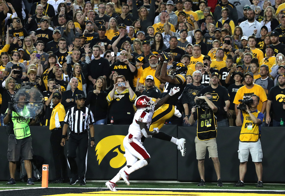 Iowa Hawkeyes wide receiver Brandon Smith (12) catches a touchdown against the Miami RedHawks Saturday, August 31, 2019 at Kinnick Stadium in Iowa City. (Brian Ray/hawkeyesports.com)