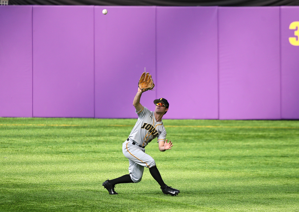 Iowa Hawkeyes outfielder Justin Jenkins (6) pulls in a fly ball for an out during the third inning of their CambriaCollegeClassic game at U.S. Bank Stadium in Minneapolis, Minn. on Friday, February 28, 2020. (Stephen Mally/hawkeyesports.com)