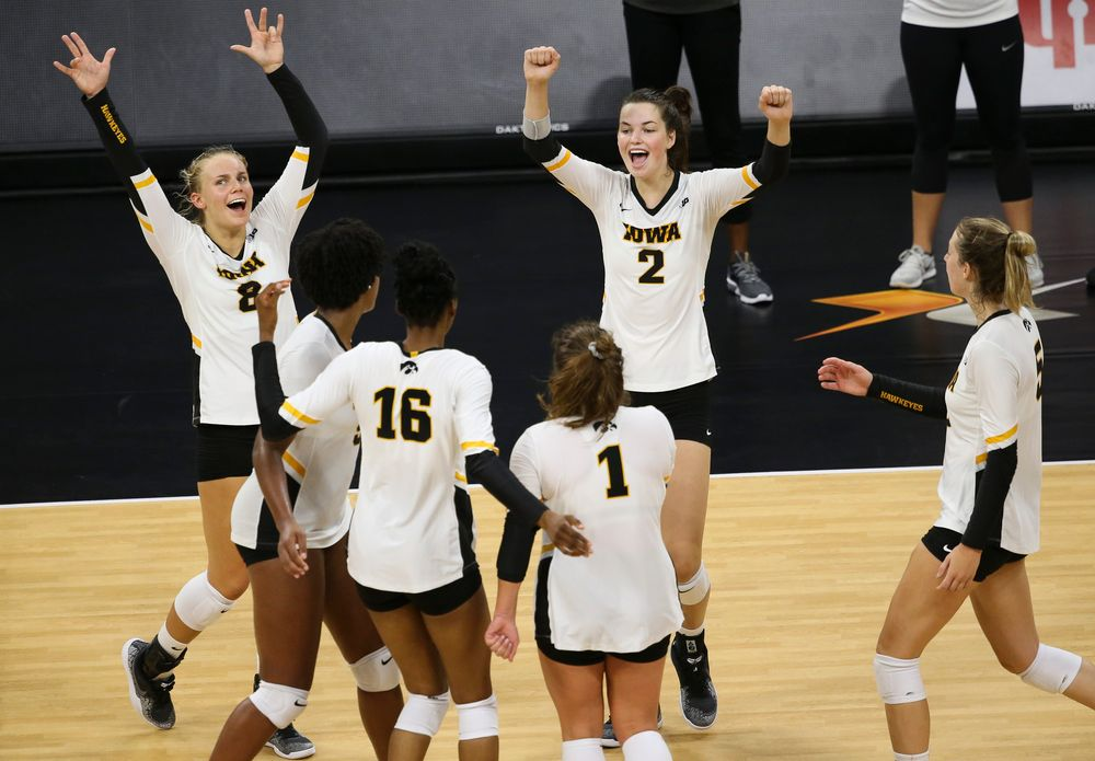 Iowa Hawkeyes right side hitter Reghan Coyle (8), Iowa Hawkeyes setter Courtney Buzzerio (2)
