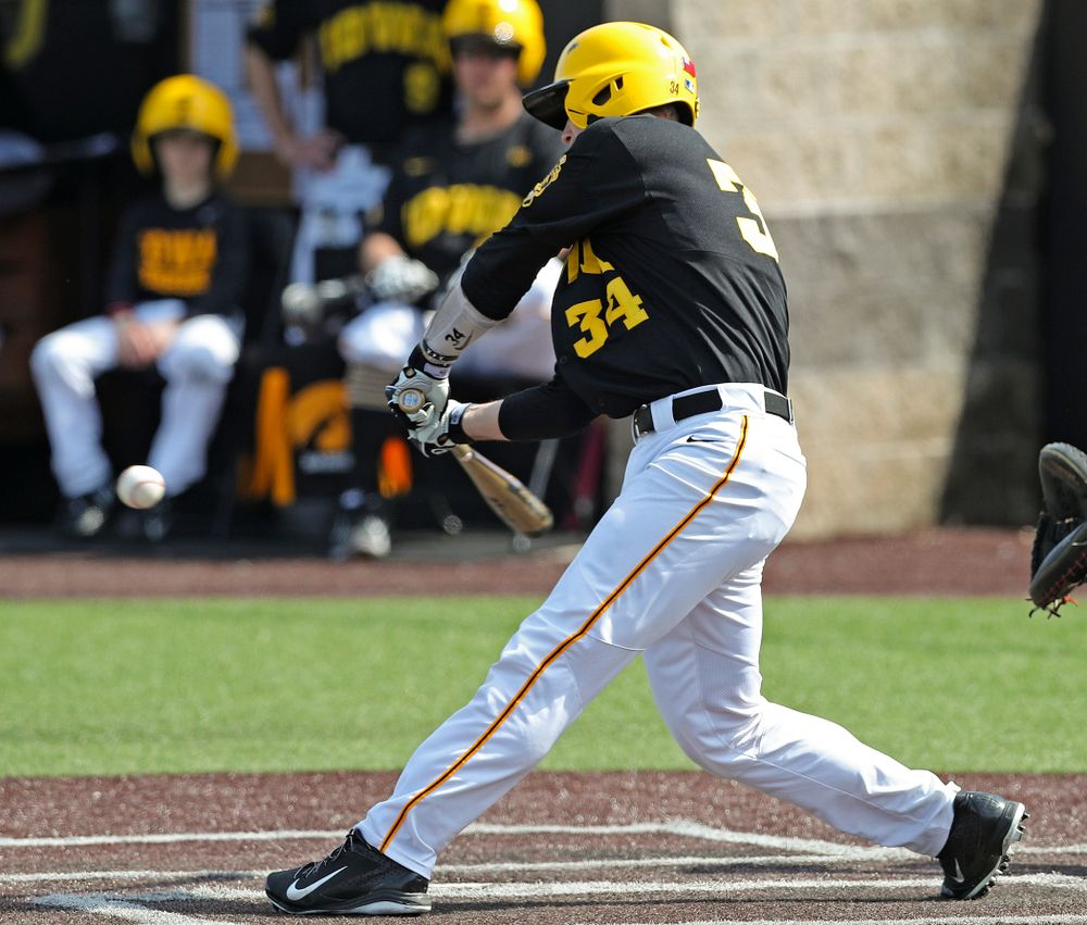 Iowa Hawkeyes catcher Austin Martin (34) drives a pitch for a hit during the third inning of their game against Rutgers at Duane Banks Field in Iowa City on Saturday, Apr. 6, 2019. (Stephen Mally/hawkeyesports.com)
