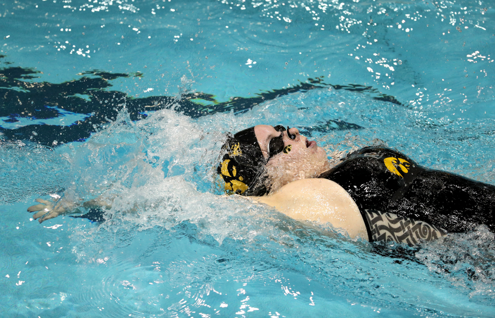 Iowa's Natalie McGovern swims the 100-yard backstroke against the Iowa State Cyclones in the Iowa Corn Cy-Hawk Series Friday, December 7, 2018 at at the Campus Recreation and Wellness Center. (Brian Ray/hawkeyesports.com)