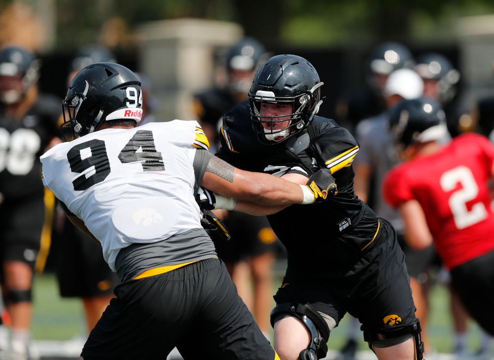 Iowa Hawkeyes offensive lineman Mark Kallenberger (71) and defensive end A.J. Epenesa (94) during fall camp practice No. 9 Friday, August 10, 2018 at the Kenyon Practice Facility. (Brian Ray/hawkeyesports.com)