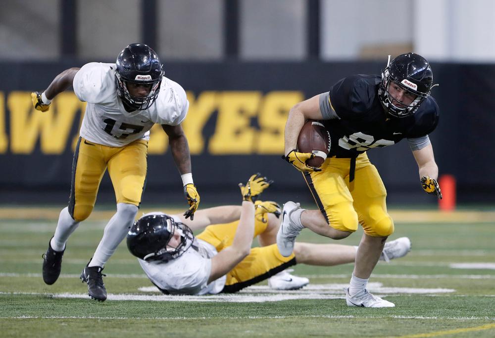 Cedric Boswell, Nico Ragaini -- University of Iowa spring football practice No. 6 on March 31, 2018, in Iowa City, Iowa. (Darren Miller/hawkeyesports.com)