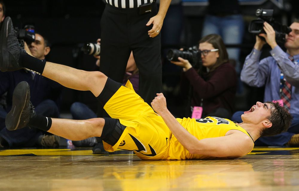 Iowa Hawkeyes forward Luka Garza (55) reacts after making a basket while being fouled against Wisconsin on November 30, 2018 at Carver-Hawkeye Arena. (Tork Mason/hawkeyesports.com)