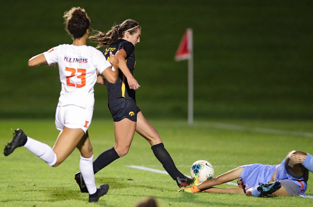 Iowa forward Kaleigh Haus (4) scores a goal during the second half of their match against Illinois at the Iowa Soccer Complex in Iowa City on Thursday, Sep 26, 2019. (Stephen Mally/hawkeyesports.com)