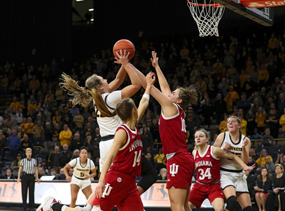 Iowa Hawkeyes guard Kathleen Doyle (22) makes a basket while being fouled during the fourth quarter of their game at Carver-Hawkeye Arena in Iowa City on Sunday, January 12, 2020. (Stephen Mally/hawkeyesports.com)