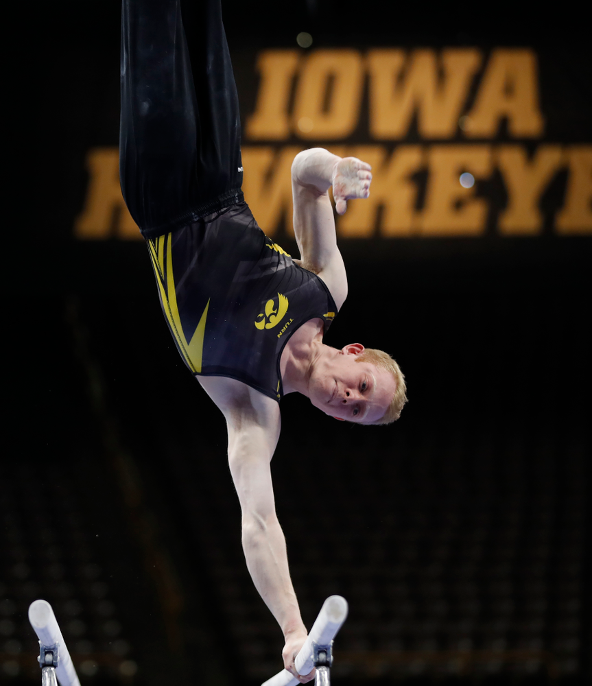 Nick Merryman competes on the bars against Minnesota and Air Force