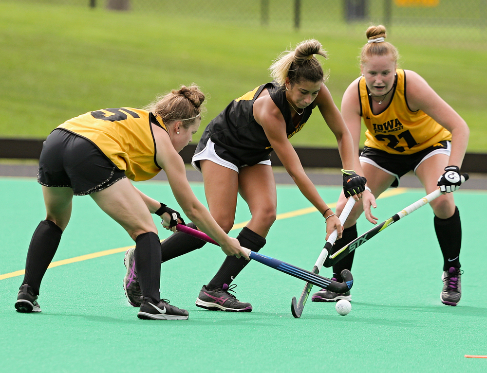 Iowa's Meghan Conroy (5), Ciara Smith (17), and Makenna Maguire (21) run a drill during practice at Grant Field in Iowa City on Thursday, Aug 15, 2019. (Stephen Mally/hawkeyesports.com)