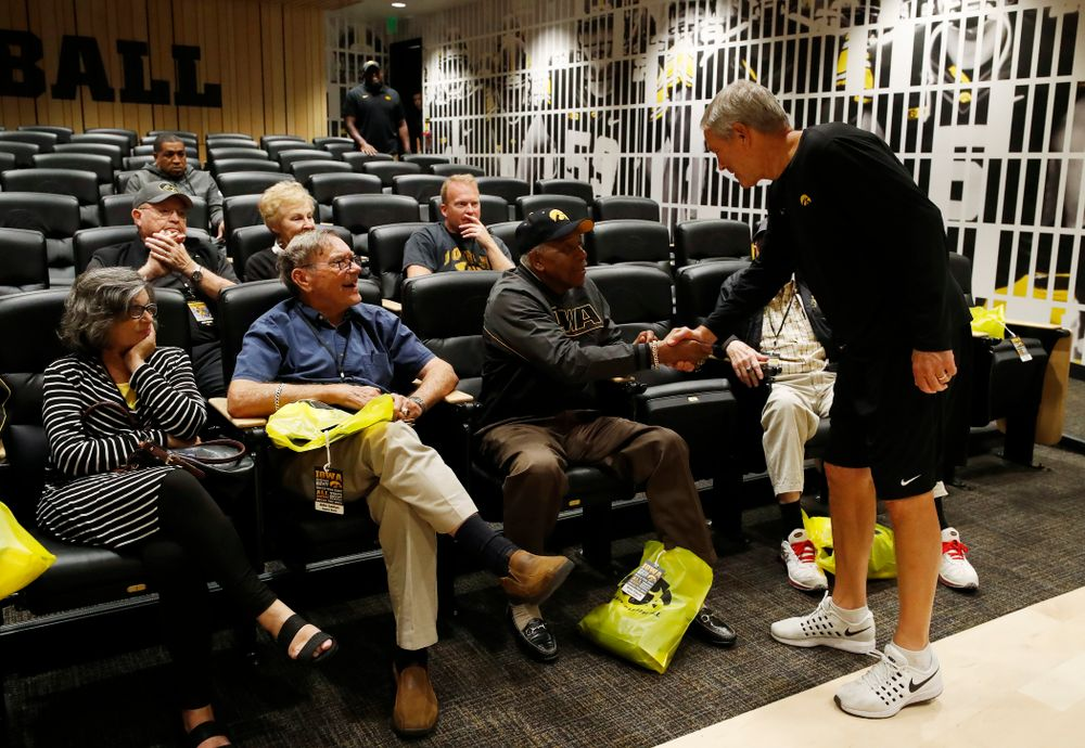 Iowa Hawkeyes head coach Kirk Ferentz shakes hands with 1958 National Championship Team running back Willie Fleming as they tour the Hansen Football Performance  Center  Friday, September 21, 2018. (Brian Ray/hawkeyesports.com)