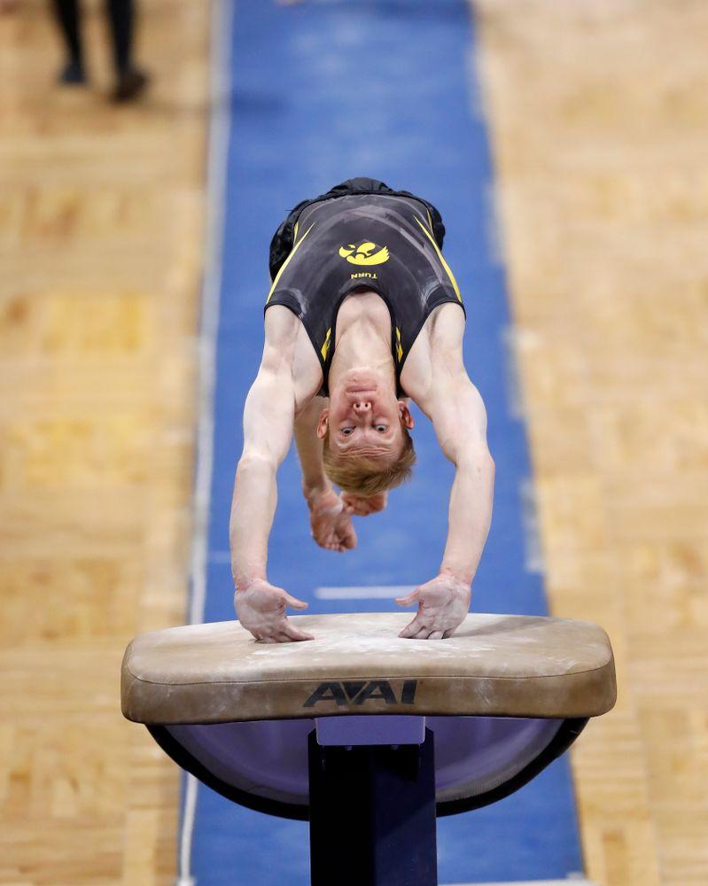 Nick Merryman competes on the vault against Illinois