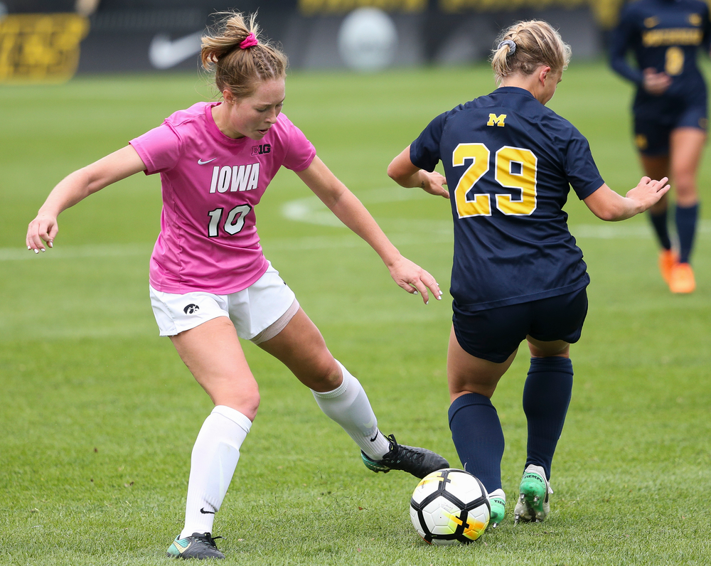 Iowa Hawkeyes midfielder Natalie Winters (10) makes a tackle during a game against Michigan at the Iowa Soccer Complex on October 14, 2018. (Tork Mason/hawkeyesports.com)